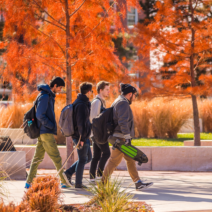 Students walking across campus during fall.