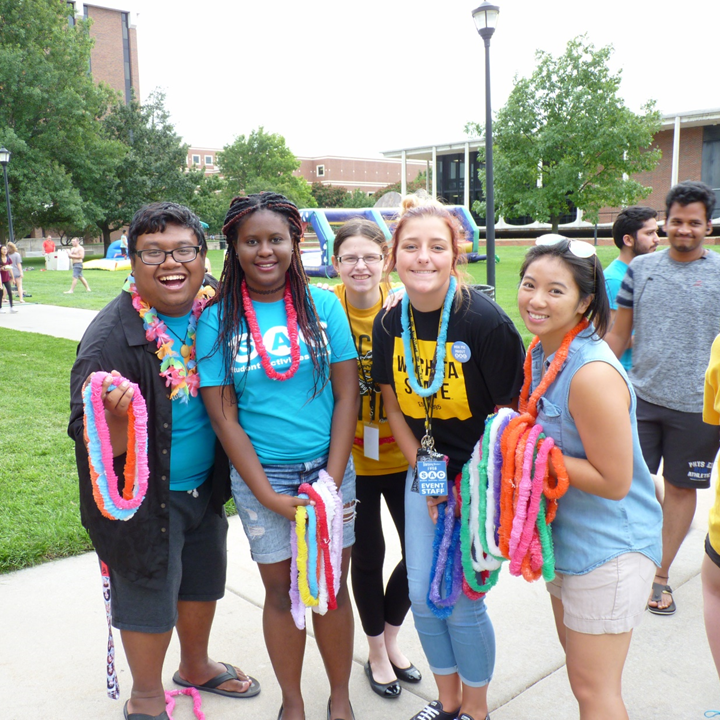 Students pose at the 2018 Aloha Party hosted by Student Involvement.