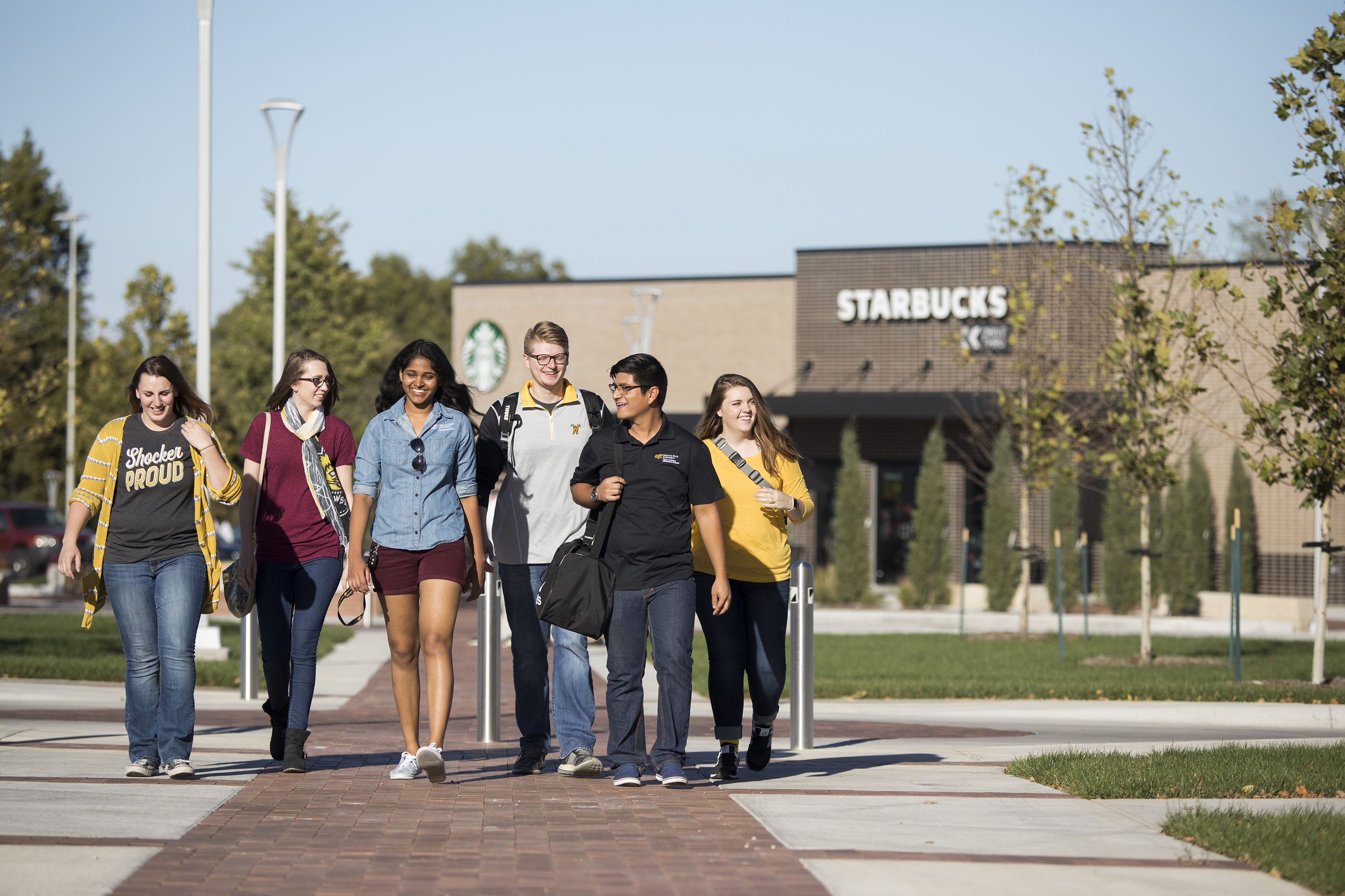 Students walking past Starbucks building