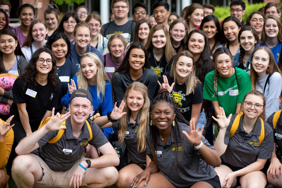 Group of smiling students at Orientation event
