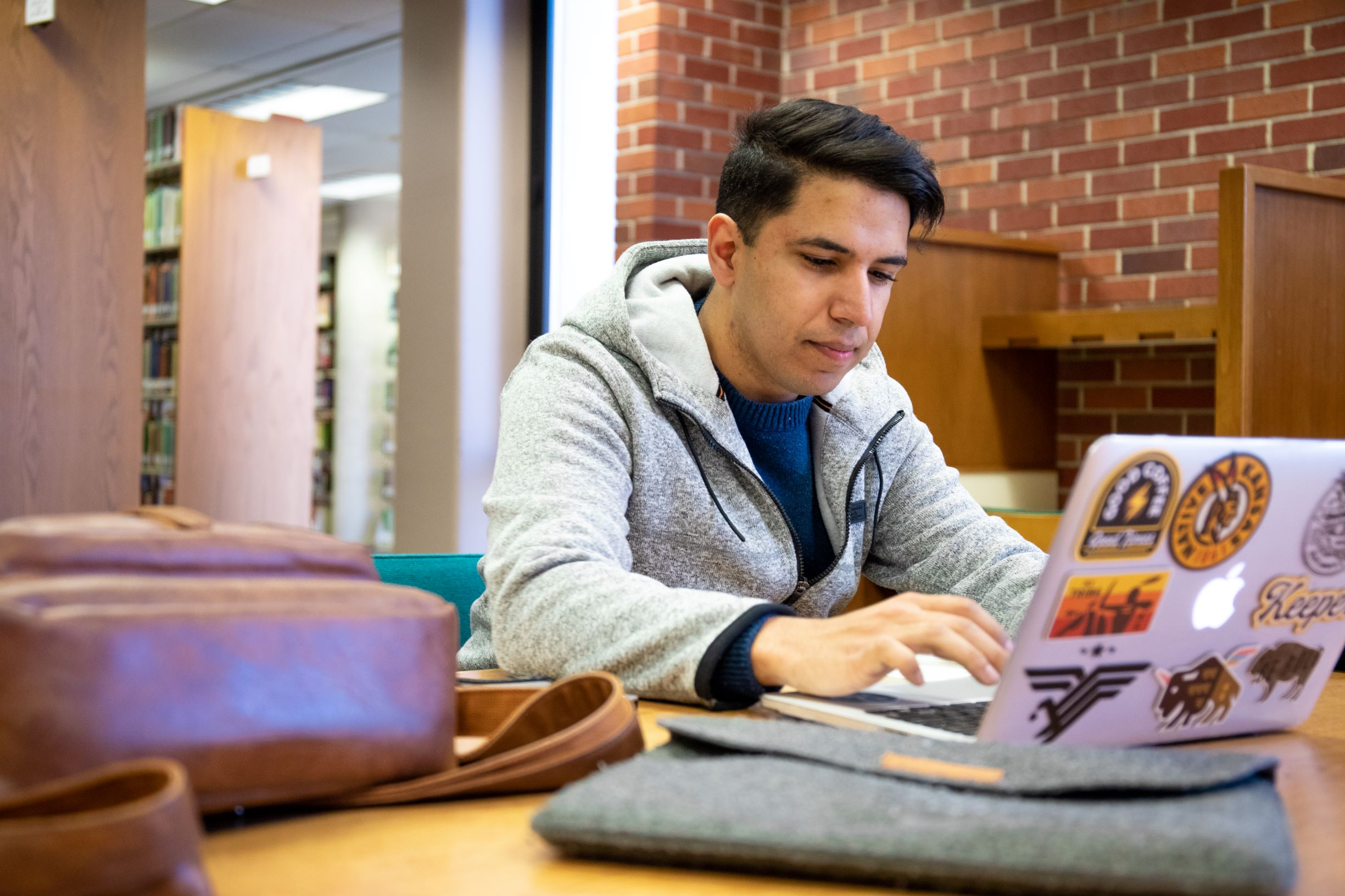 male WSU student studying with laptop