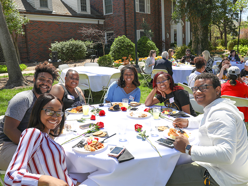 Unity Picnic, diverse group students at tables outdoor