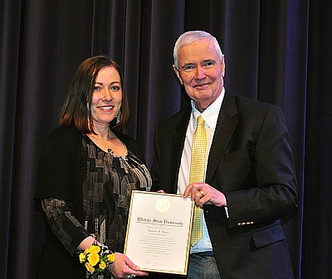 Danielle Gabor receiving the President's Distinguished Service Award from President Bardo on April 30, 2014.