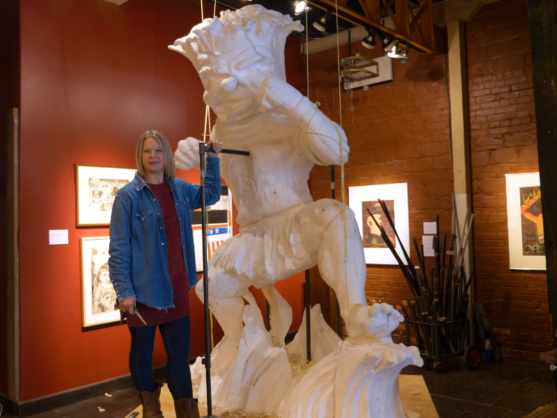 Artist Connie Ernat with a lifesize replica of the WuShock sculpture