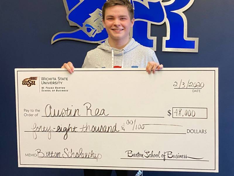 Austin Rea holding a big check