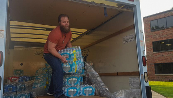 Last fall, the Student Veterans Organization collected supplies for victims of Hurricane Harvey. Marine Michael Bearth helped unload three pallets of water bottles to send to Houston.