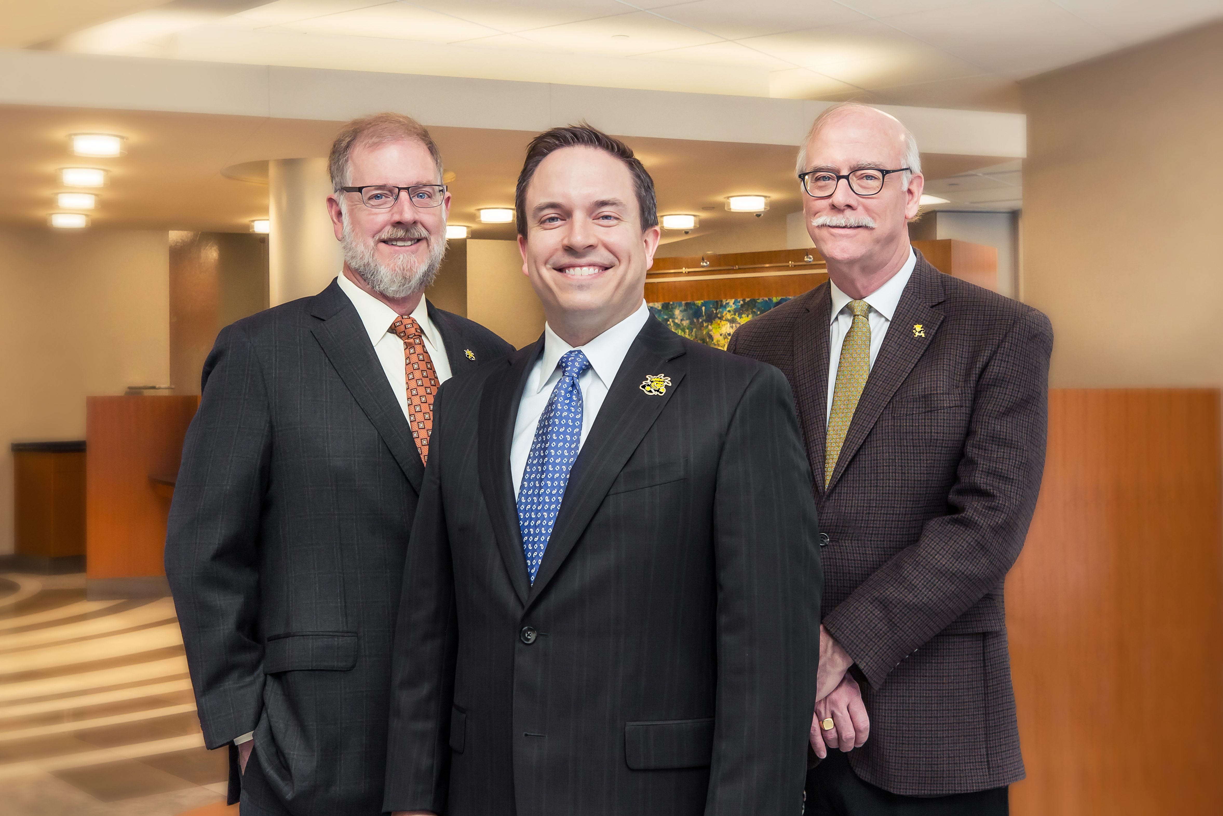 Members of the Bastian family and their family-owned Fidelity Bank have contributed $1 million to Wichita State University to help build a new home for the W. Frank Barton School of Business. From left are Clark Bastian, Aaron Bastian and Clay Bastian.