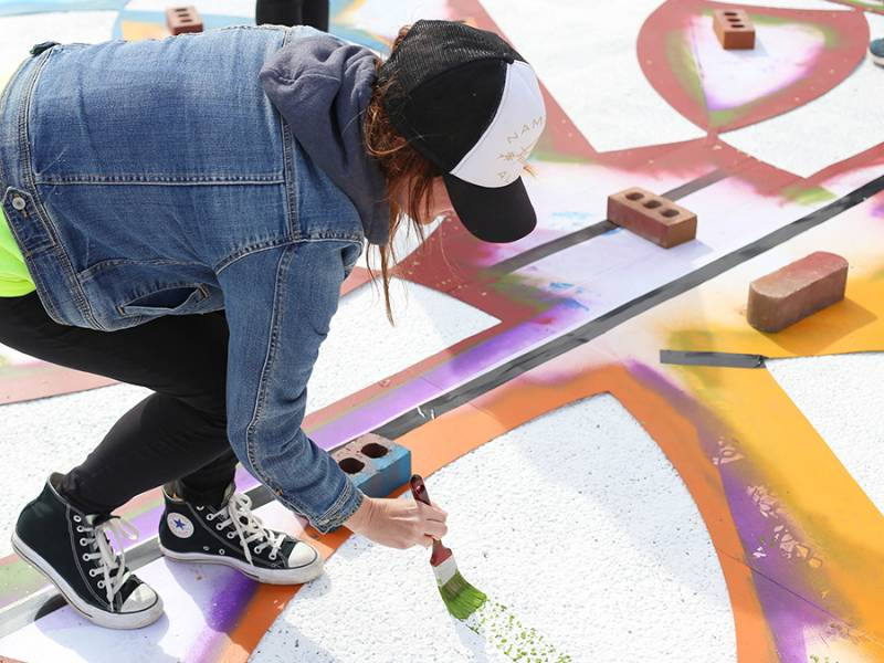 Students paint a street mural