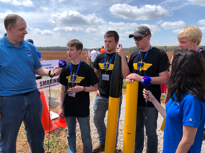 Wichita State SLI team interviews with NASA correspondents after their rocket launch. Photo credit: Scott Miller