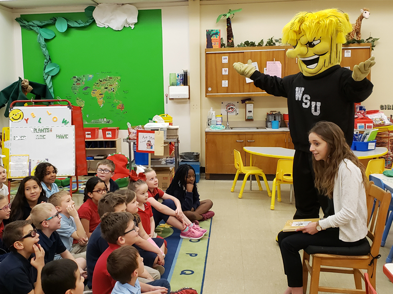 The PRI's Meghan Carver and WuShock speak with a local elementary school class.