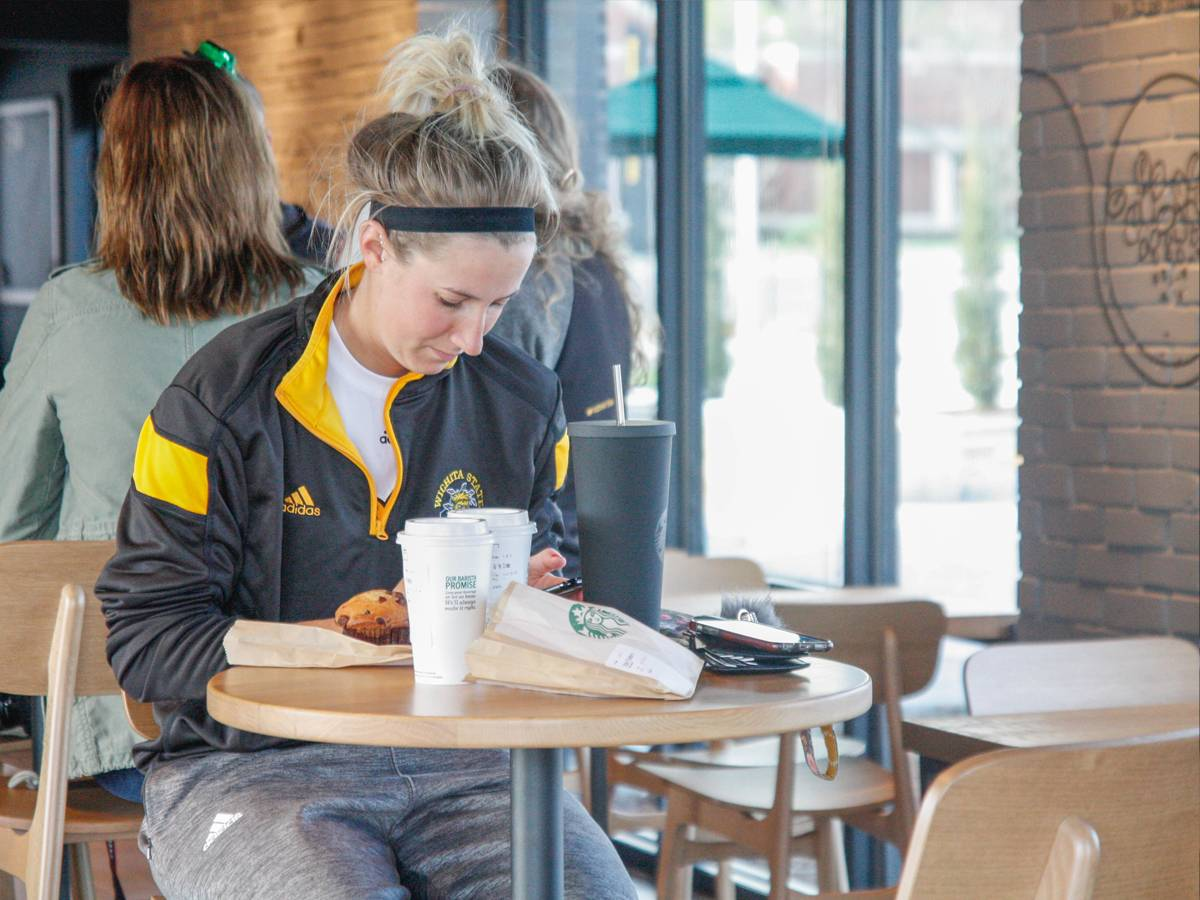 WSU student enjoys coffee at the Braeburn Square Starbucks