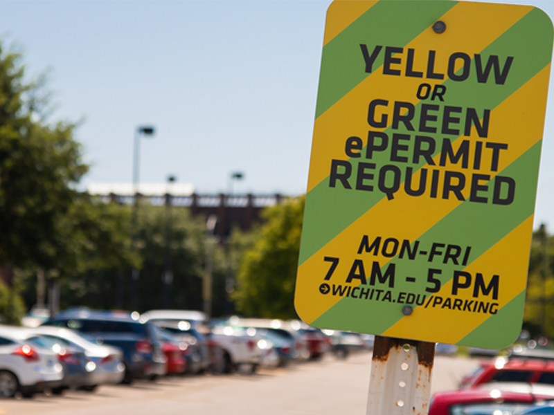 Green and yellow parking sign near Duerksen