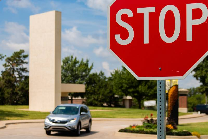 New stop signs facing Perimeter Road on Memorial Drive