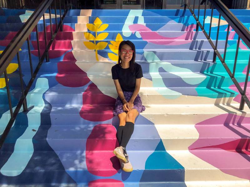 Senior Honors student Sarah Myose designed and painted a mural on the Clinton Hall staircase.