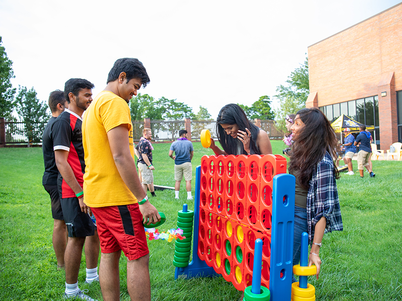 Students play giant connect four
