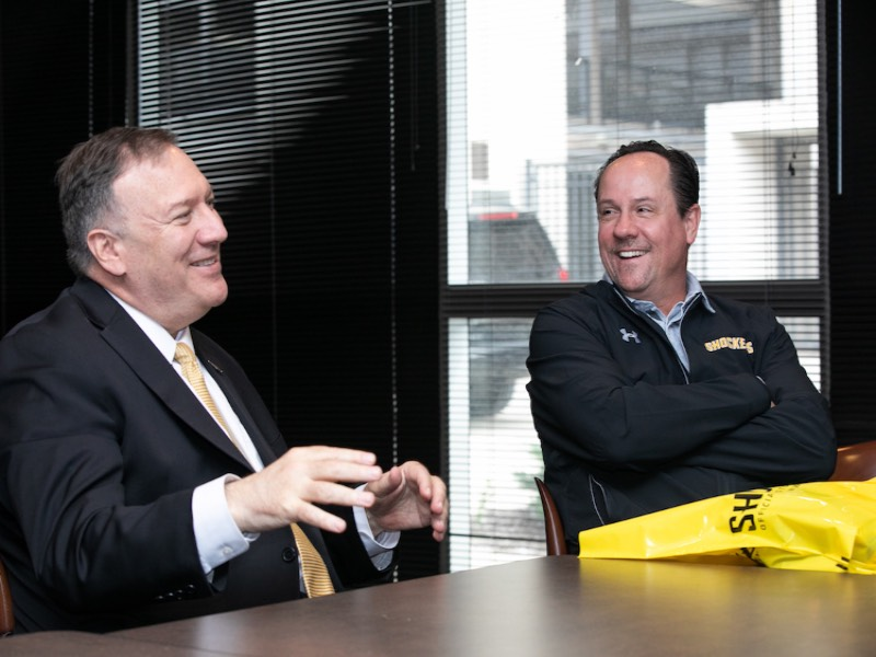 Secretary of State Mike Pompeo (right) and Wichita State basketball coach Gregg Marshall,