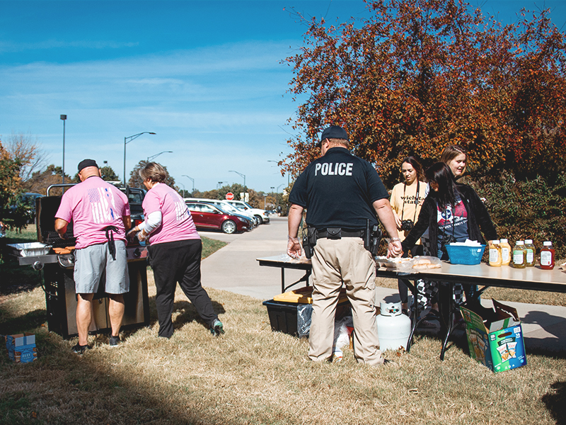 WSUPD serving food at a pop-up picnic