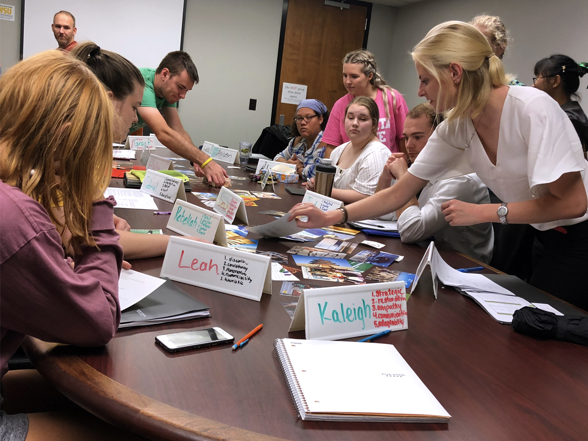 "Students in HNRS 152F ""Leadership Challenge"" perform a StrengthsFinder activity in an Ahlberg Hall conference room."