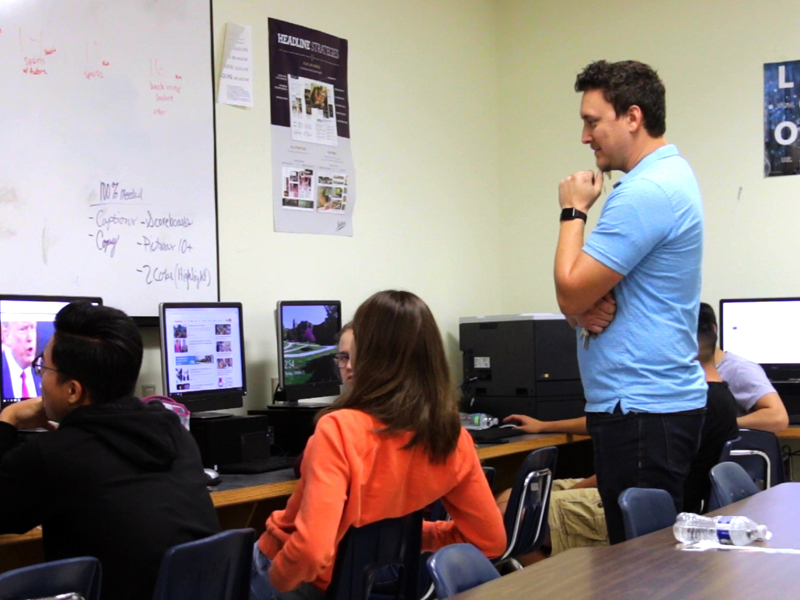 Austin Clift instructs students in his photo imaging class at Wichita East High School