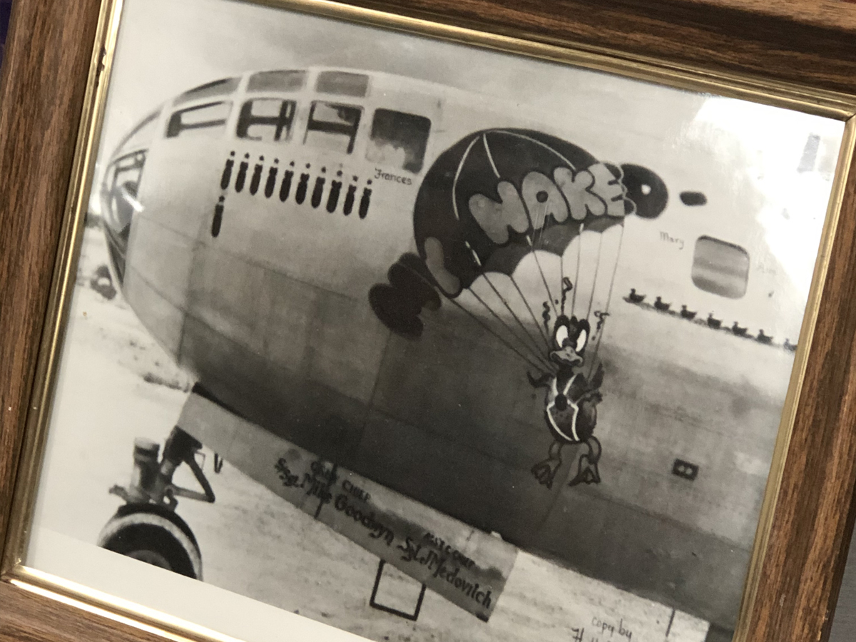 "Martin's framed picture of his B-29B bomber, named ""My Naked."" ""We were tired of half-naked women on airplanes, so we called ours, 'My Naked,'"" Martin said."