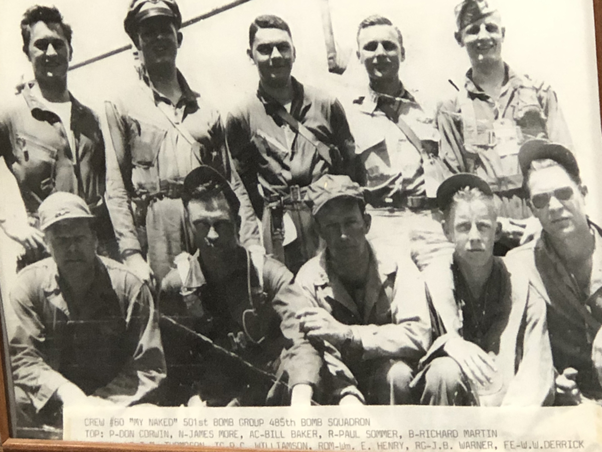 A framed photo of Martin's crew of ten men during World War II.
