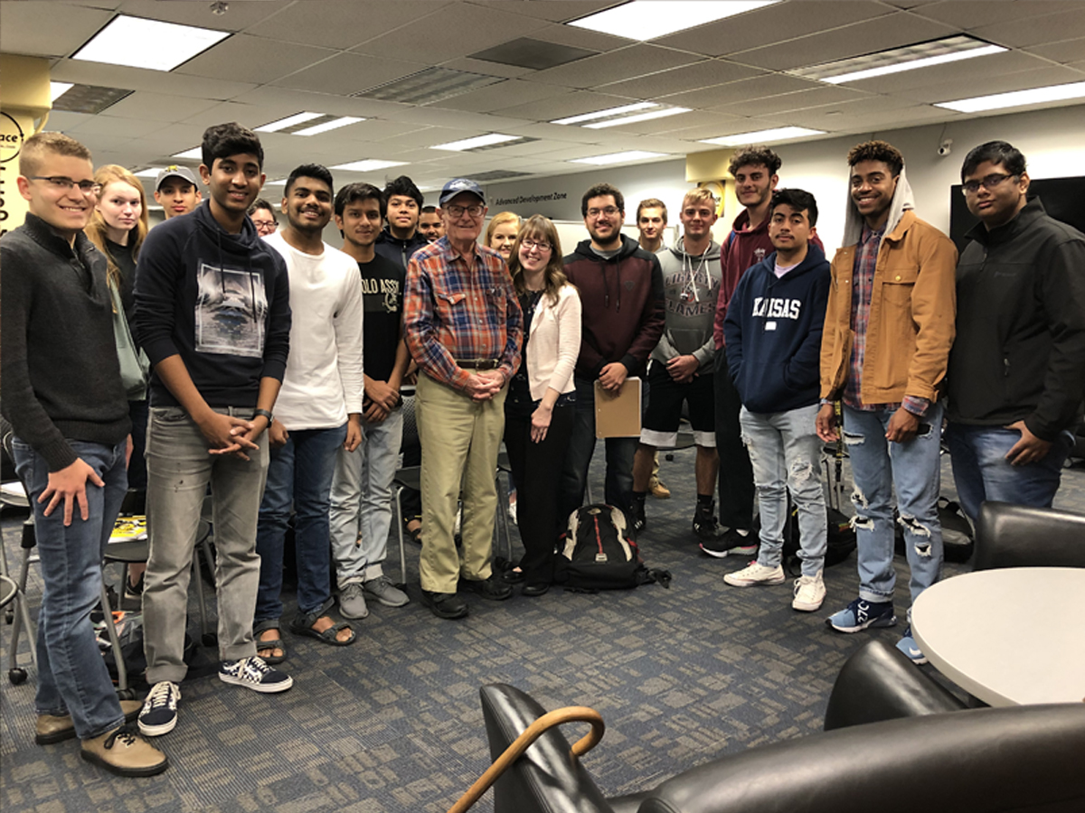 Students, faculty and staff stand with Richard Martin in a group picture in the Ablah Library C-Space