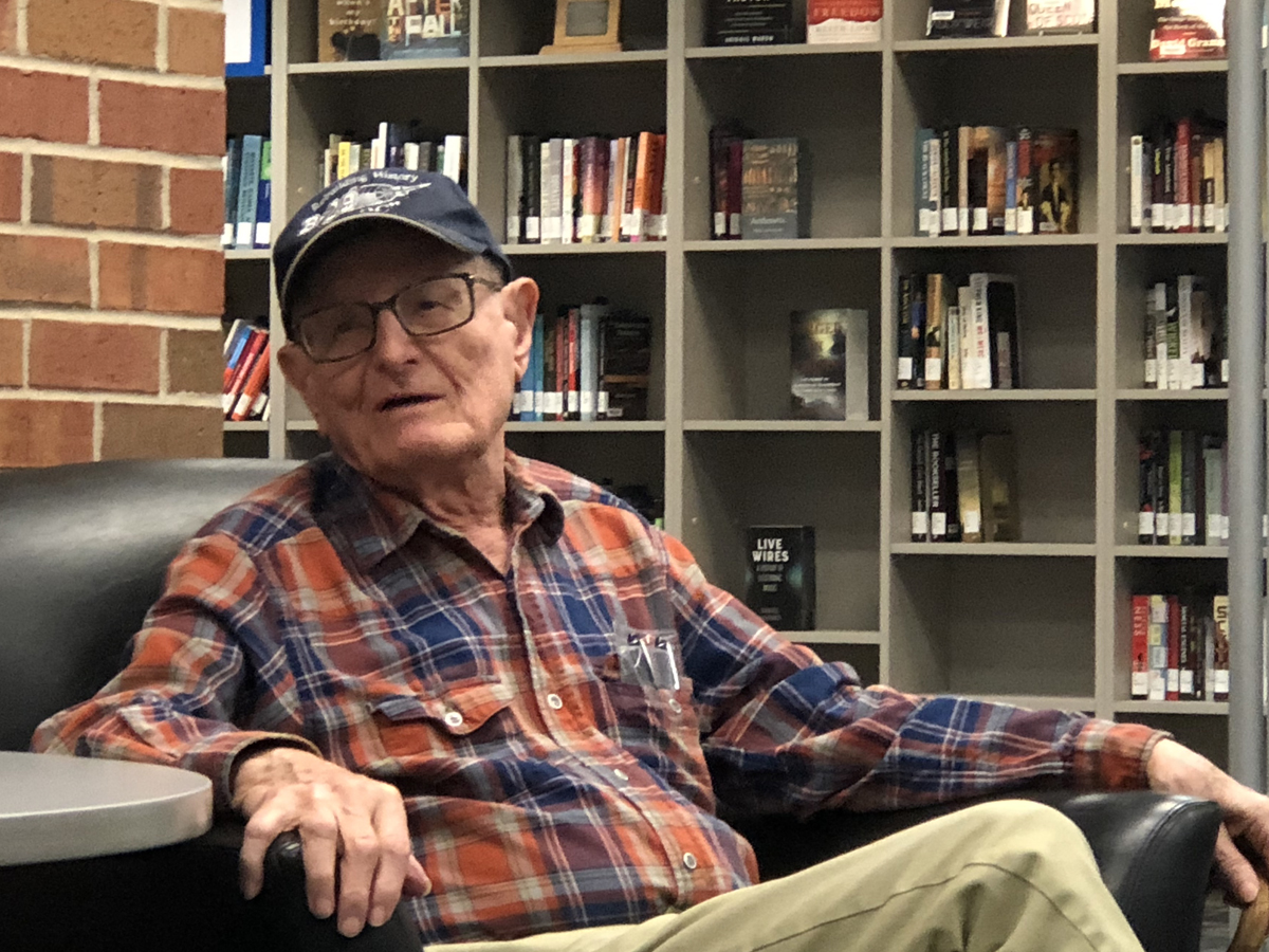 Richard Martin, World War II veteran, served on a B-29 bomber over Japan. In this image, he speaks to the class in the Ablah Library C-Space.
