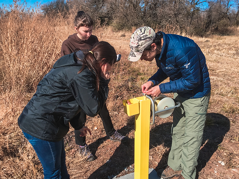 Students use a well at the new hydrogeology site