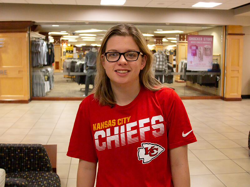 Natalie Dutton, a sport management student, shows off her Kansas City Chiefs gear.