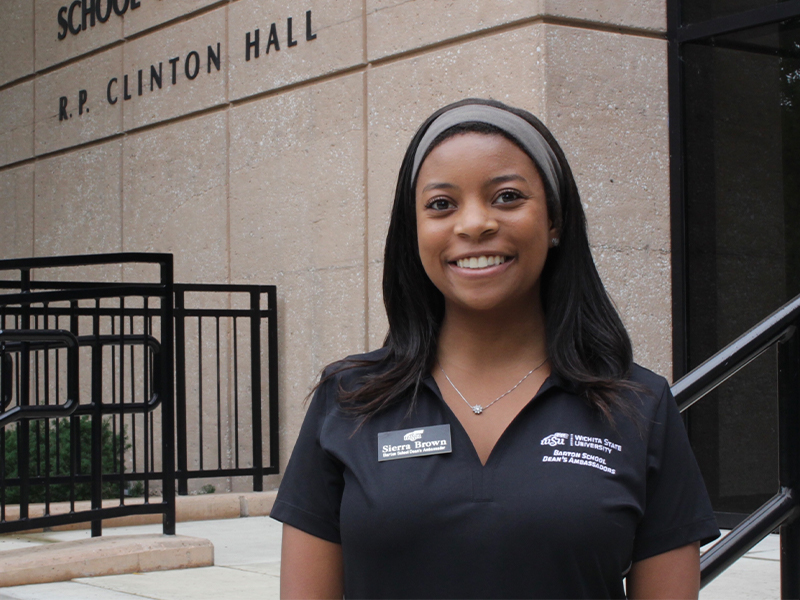 Sierra Brown standing in front of Clinton Hall