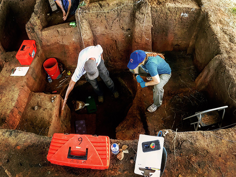 Archaeology researchers digging underground