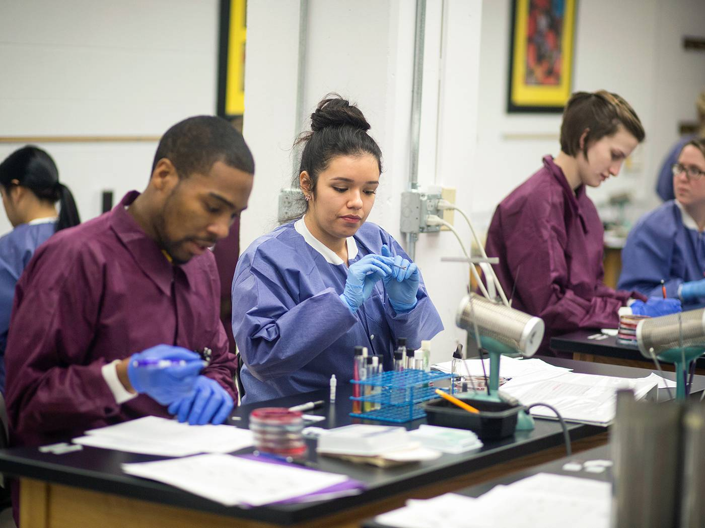 Health Professions students in clinic wearing scrubs