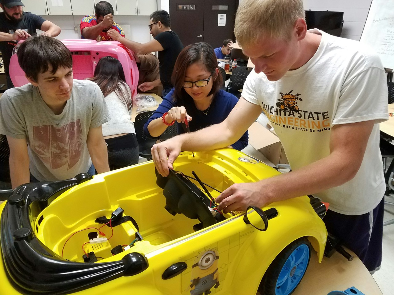 Students working on a demo car
