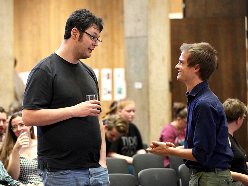 Creative writing students mingle at an event