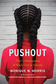 Front cover of Pushout shows back view of young black girl with braids and a red shirt.