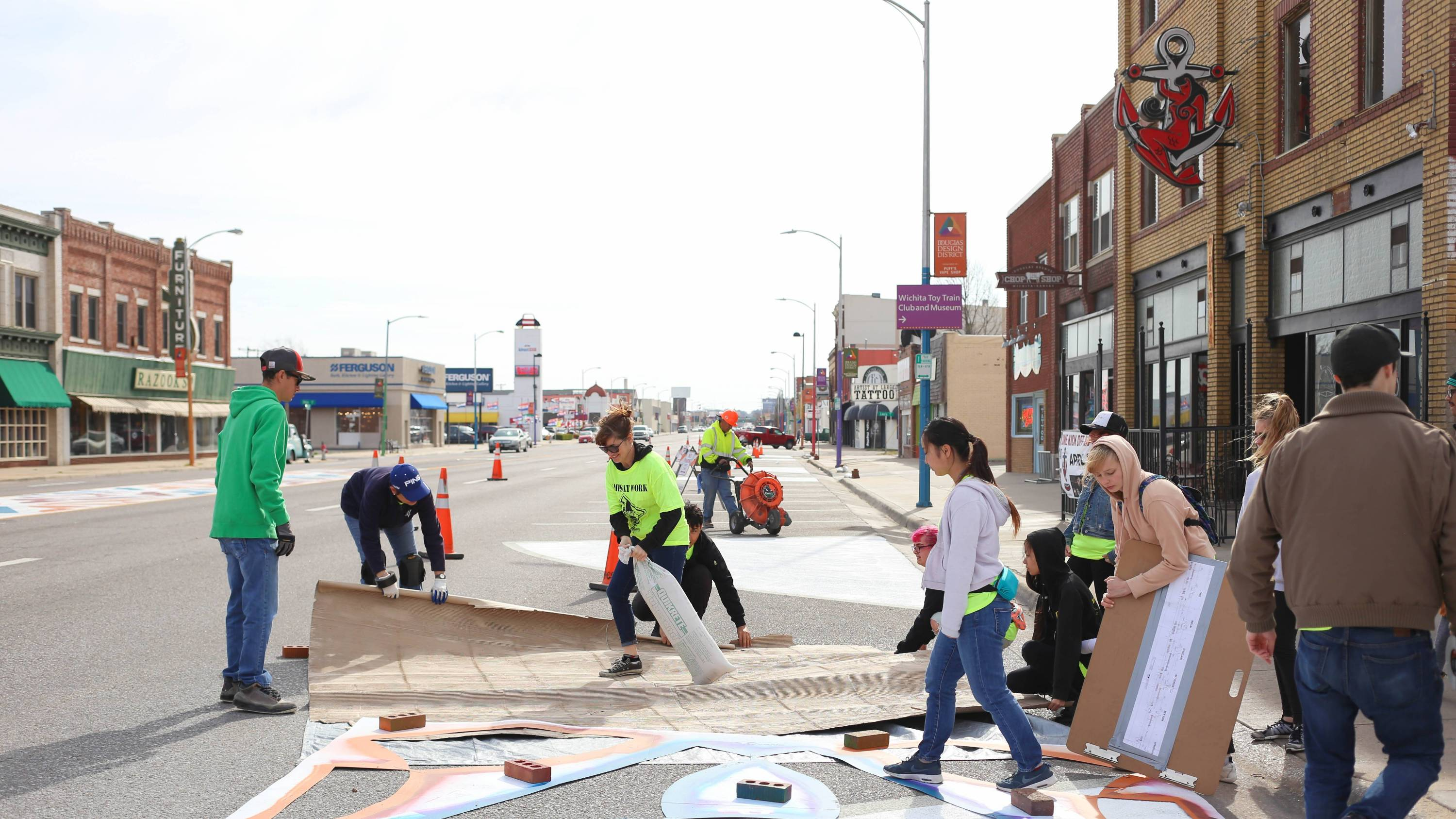 Shocker Students work on a Douglas Design District Street Mural