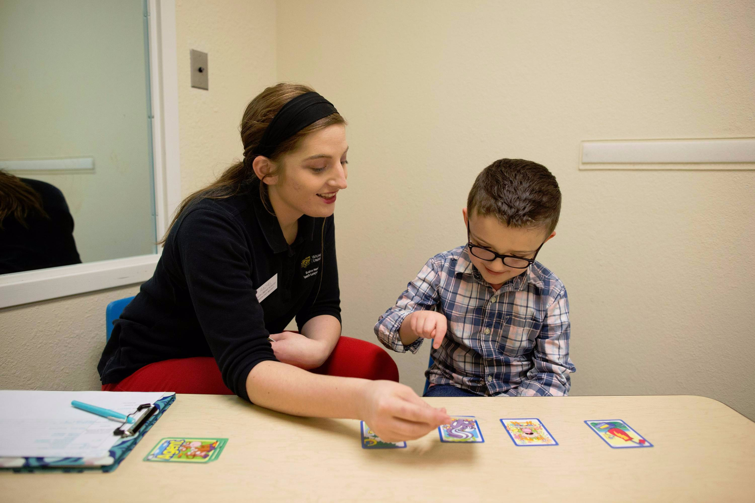 Speech-Language Pathology student working with child