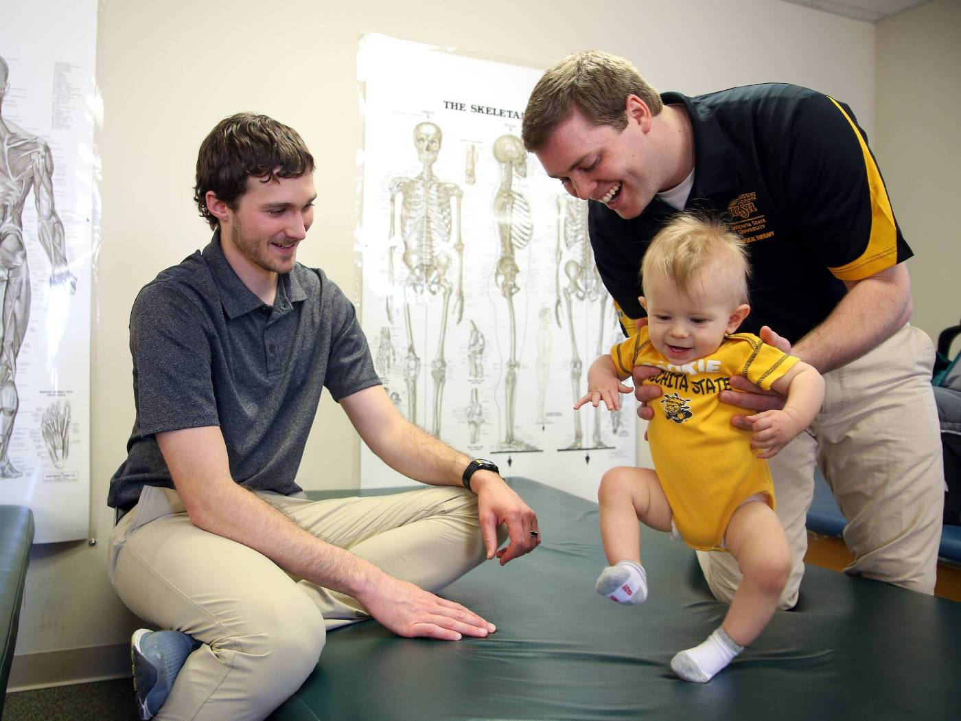 Physical therapy students with baby on baby day