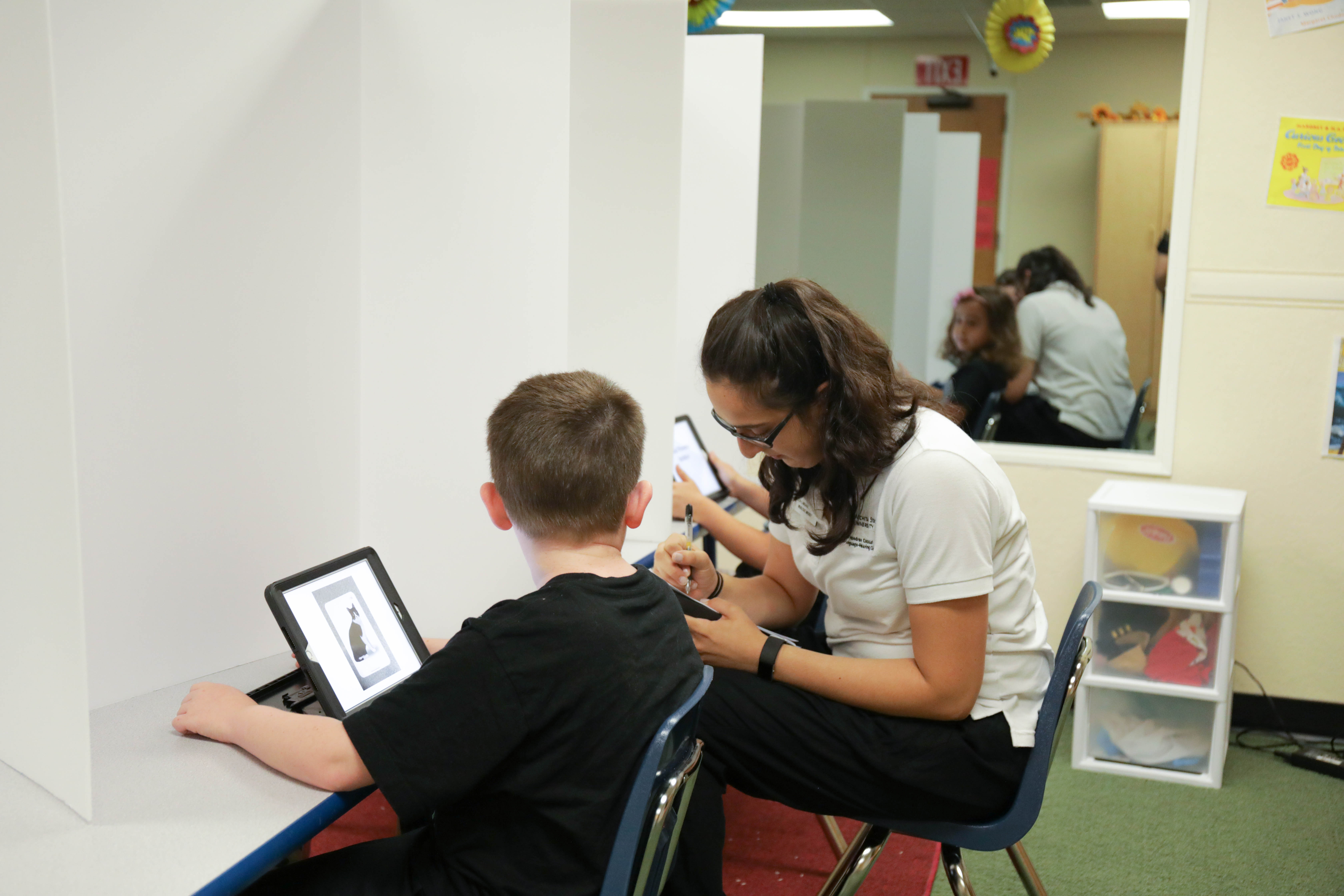 student working with child during Literacy Camp