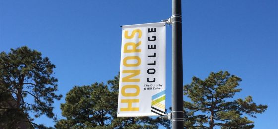 Honors College banner on a pole