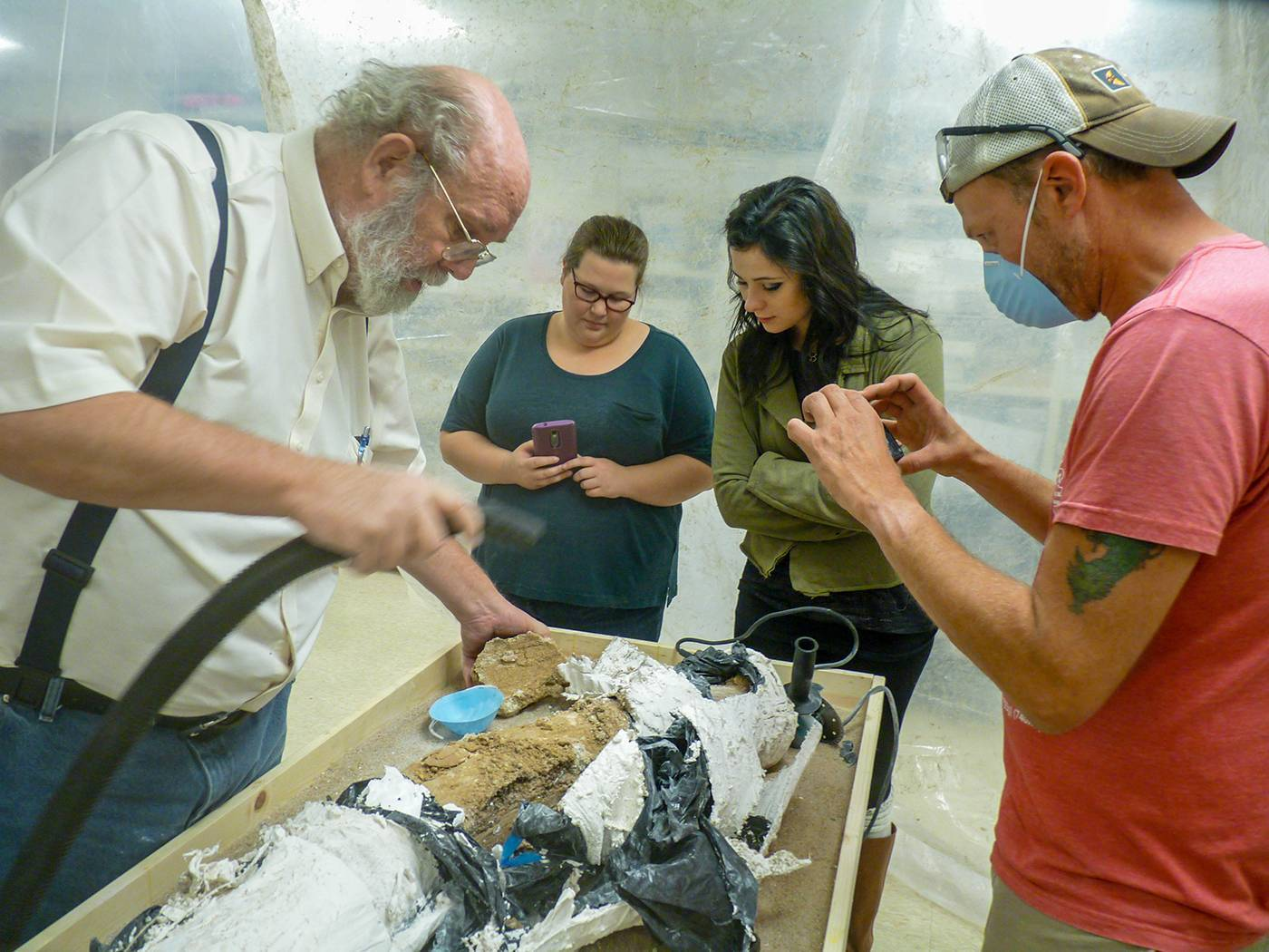 WSU students and professor work to excavate a mammoth tusk discovered in Cunningham, Kansas
