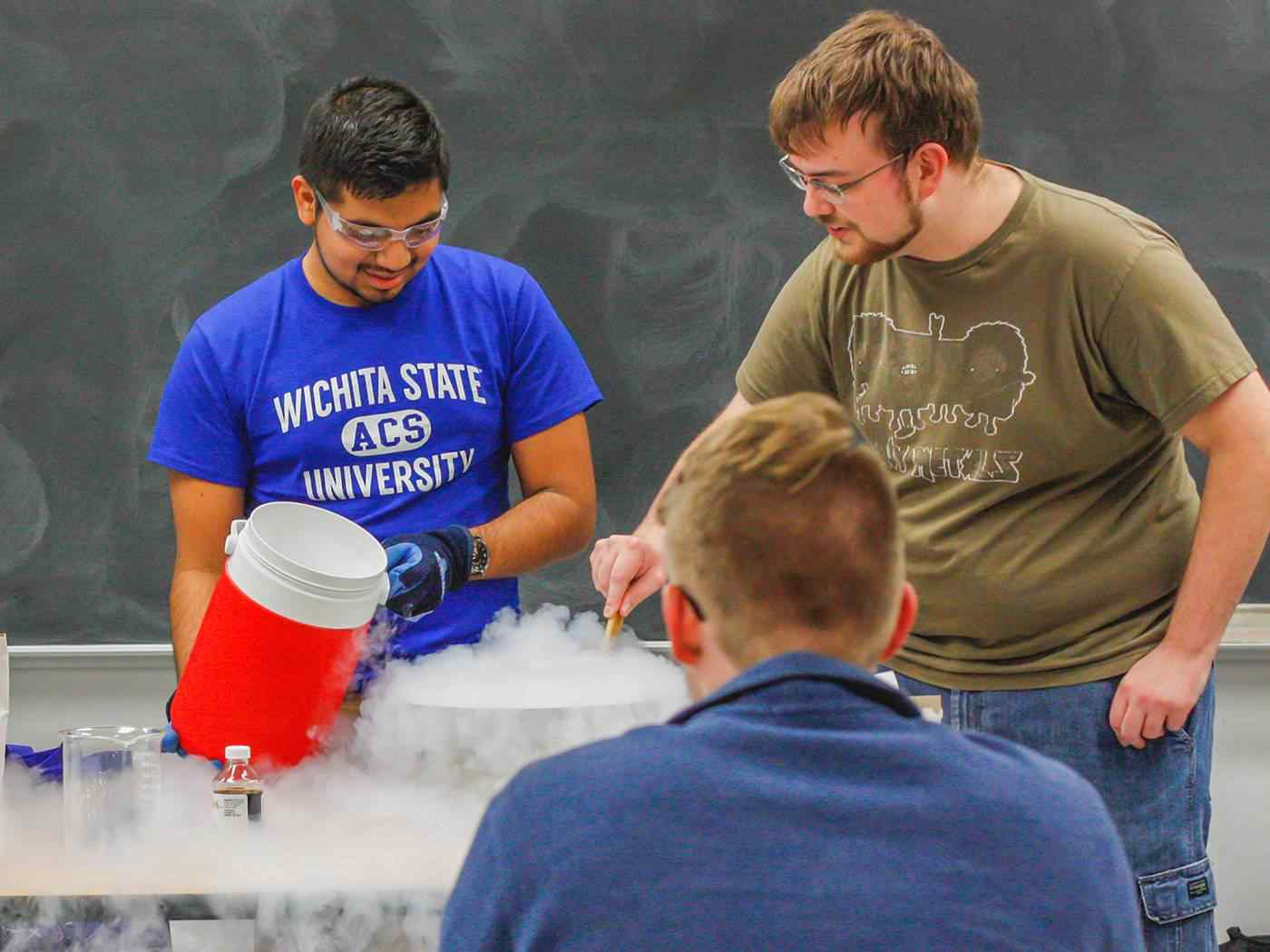 Student members of the American Chemical Society conduct a liquid nitrogen ice cream demonstration