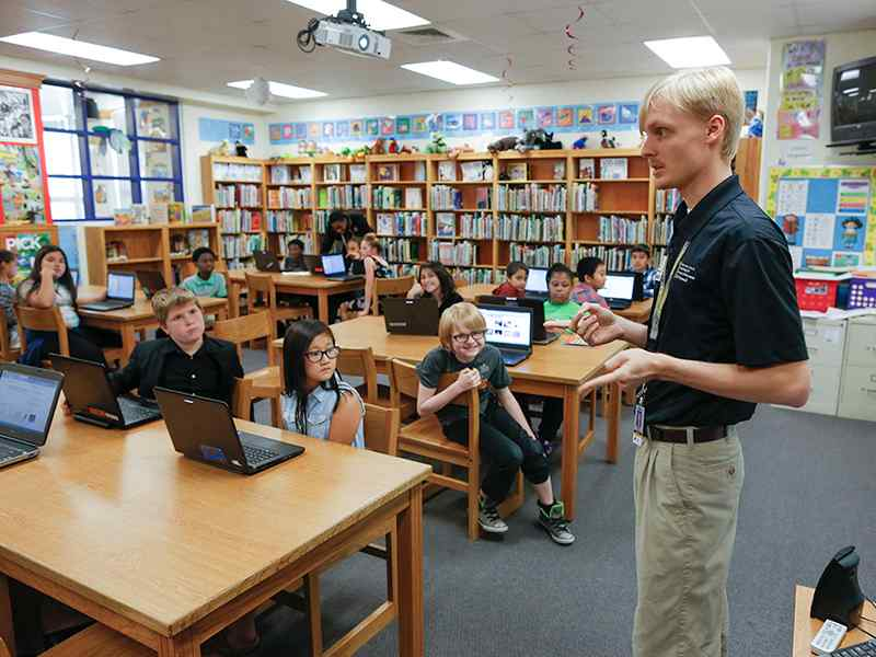 Sophomore Zane Storlie developed a curriculum on Scratch, an entry-level coding program, for Wichita elementary school students.