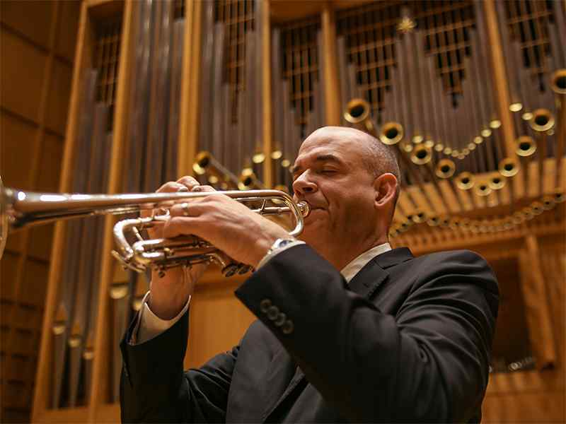 David Hunsicker is a trumpet professor who invented a device to make it easier to play the trumpet.