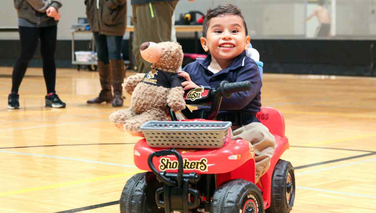 Students help modify cars for children with disabilities.