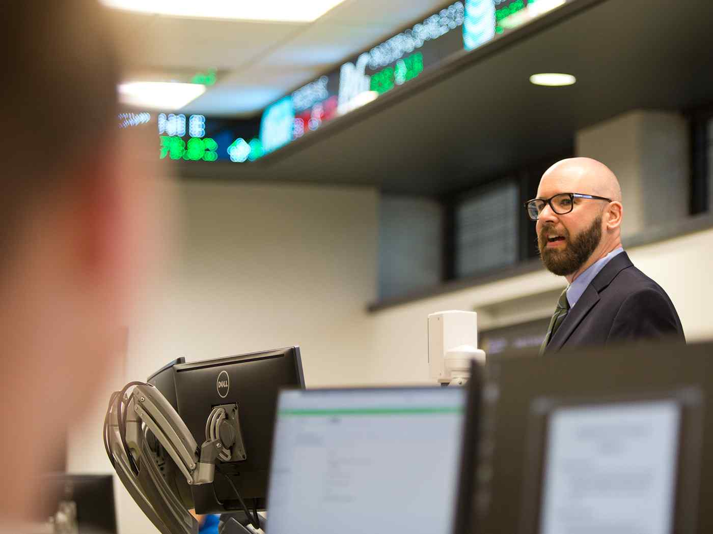 Professor teaching in trading center