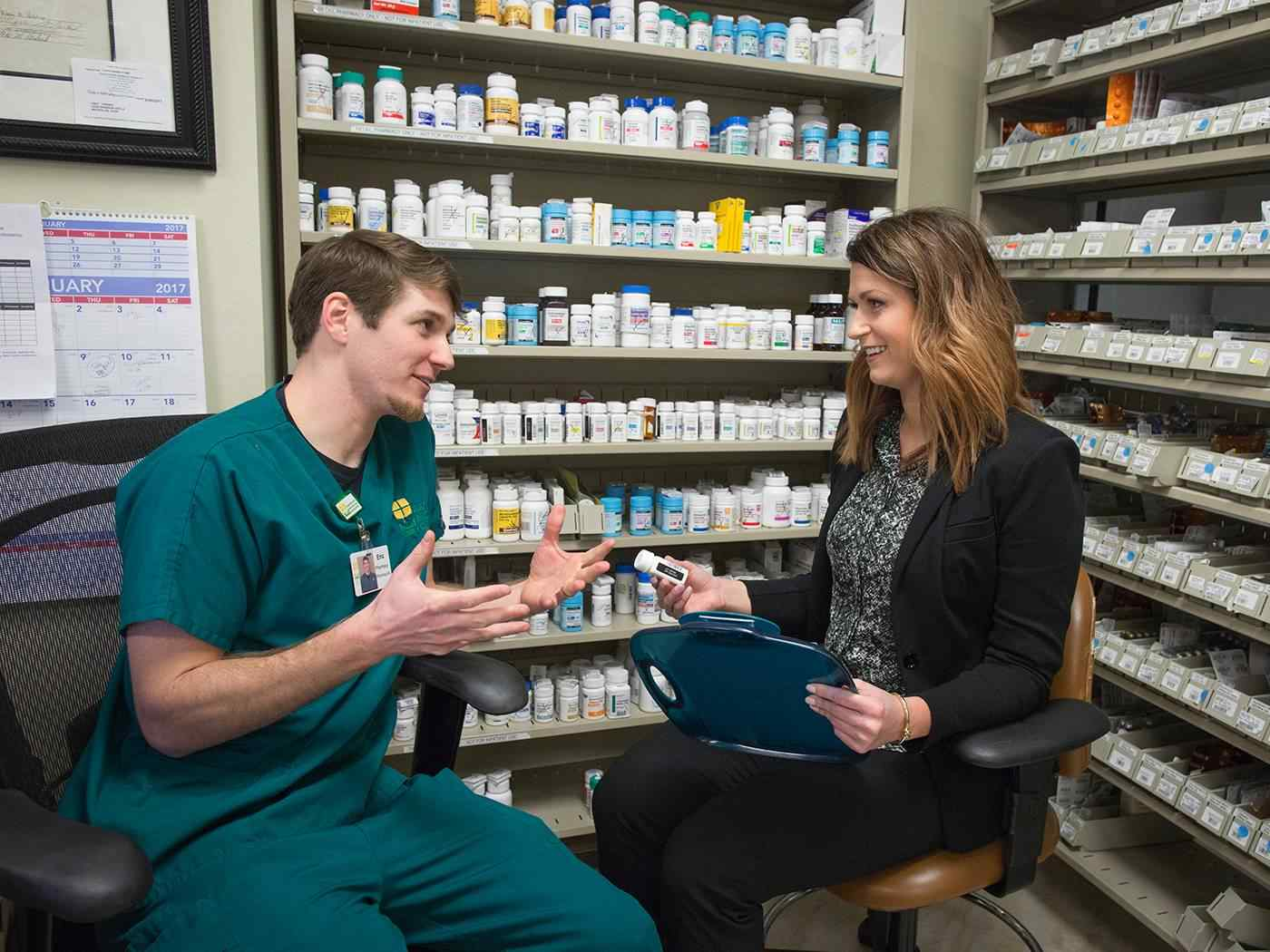 Student speaks with representative about prescriptions.