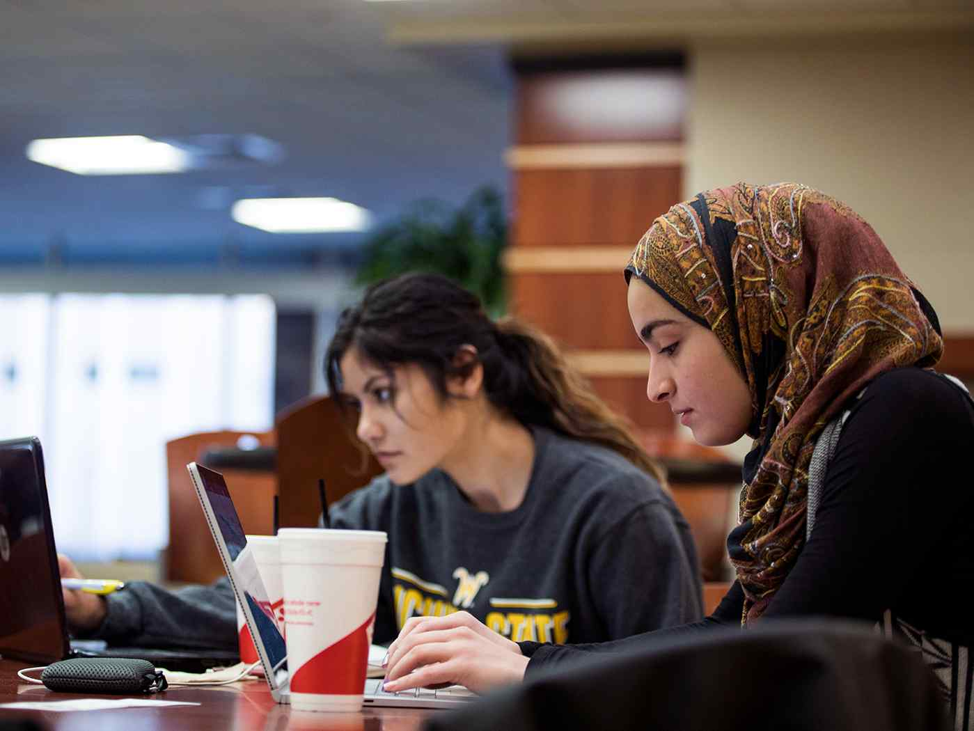 Female students study for finals in the Rhatigan Student Center
