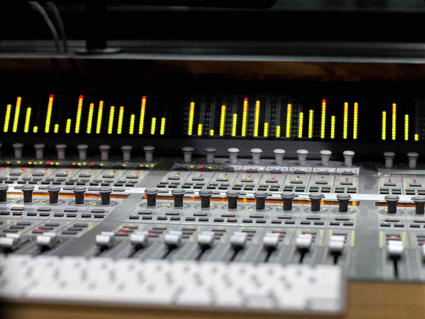 Recording music on control desk.