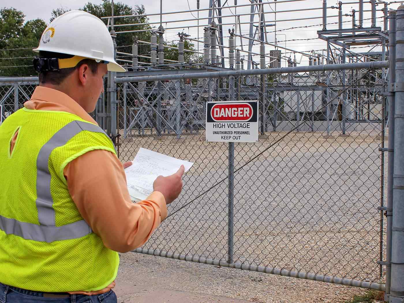 WSU intern working at electric substation.